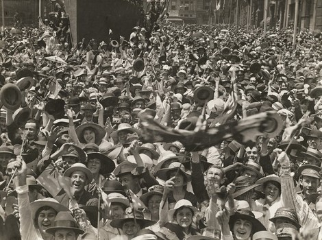 Origins of Remembrance Day: A crowd in Martin Place celebrates the news of the signing of the armistice. © Australian War Memorial (AWM)